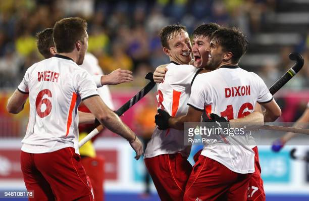 England players celebrate victory in the Men's bronze medal match between England and India during Hockey on day 10 of the Gold Coast 2018...