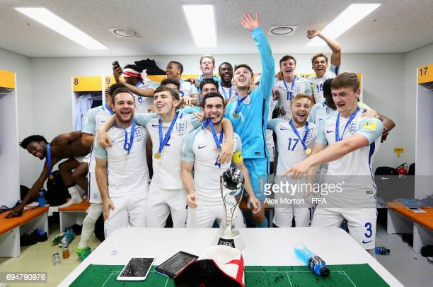 England players celebrate victory with the trophy in the dressing room after the FIFA U20 World Cup Korea Republic 2017 Final between Venezuela and...