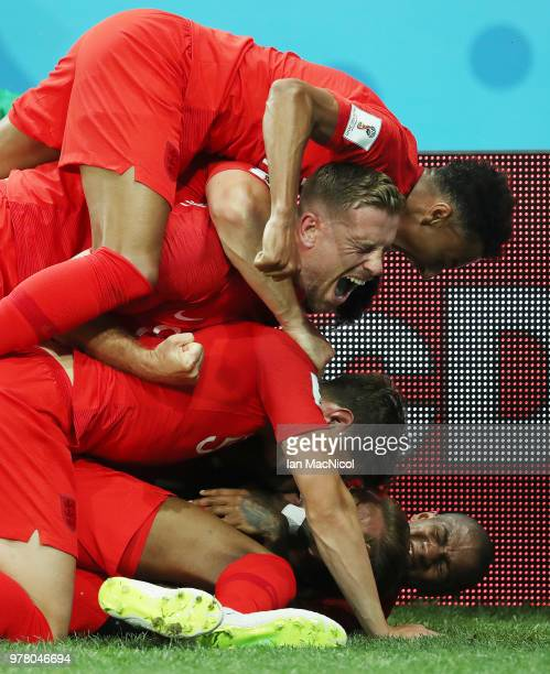 England players celebrate with Harry Kane after he scores thriver second goal during the 2018 FIFA World Cup Russia group G match between Tunisia and...