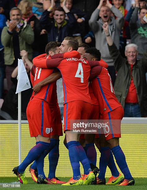England players celebrate with Marcus Rashford after he scored in the first half during the International Friendly match between England and...