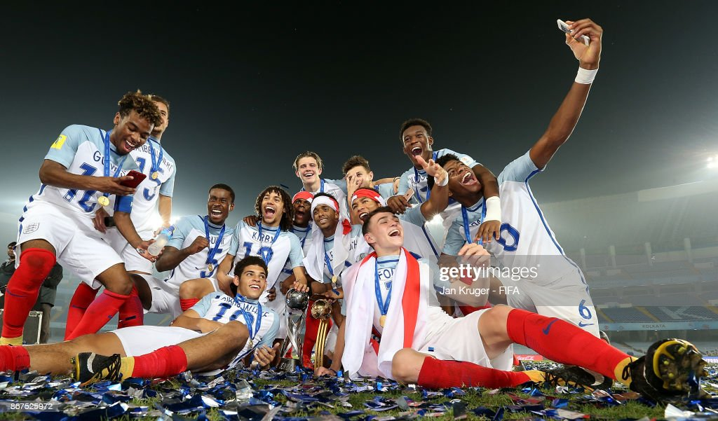 England players celebrate with the trophy during the FIFA U-17 World Cup India 2017 Final match between England and Spain at Vivekananda Yuba Bharati Krirangan on October 28, 2017 in Kolkata, India.