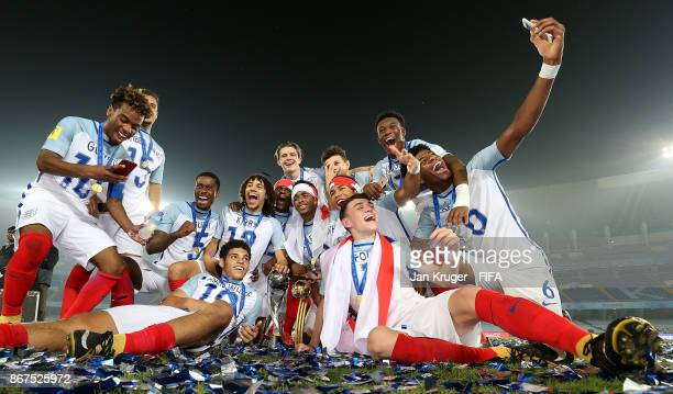 England players celebrate with the trophy during the FIFA U17 World Cup India 2017 Final match between England and Spain at Vivekananda Yuba Bharati...