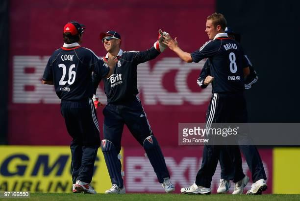 England players congratulate bowler Stuart Broad after he took a Bangladesh wicket during the 1st ODI between Bangladesh and England at ShereeBangla...