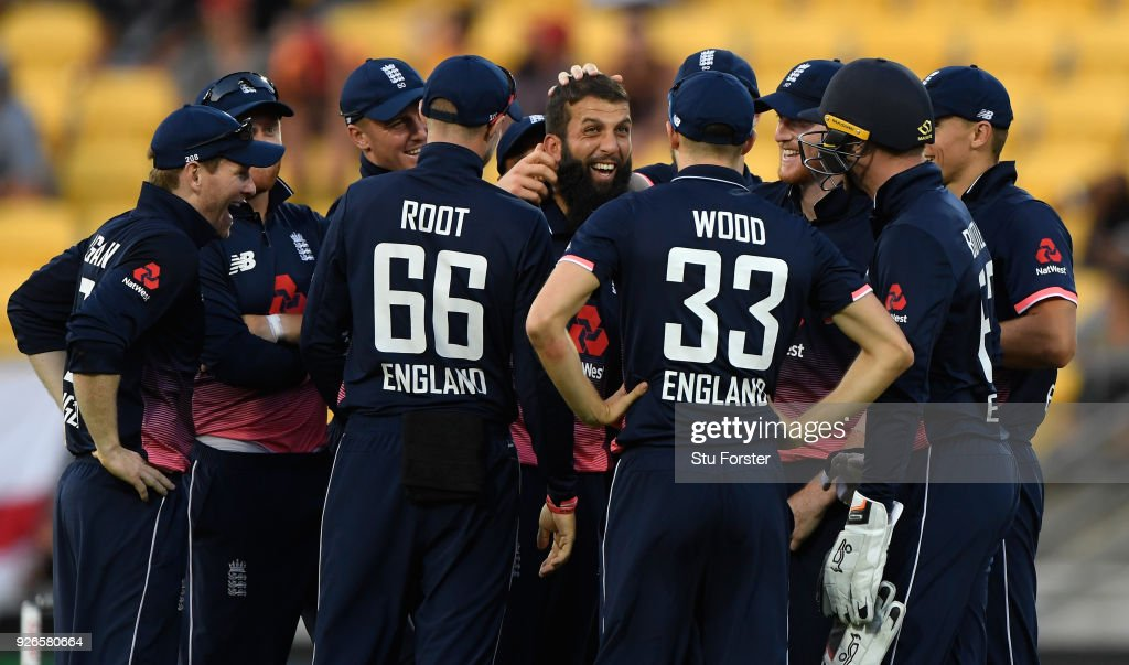 England players congratulate Moeen Ali (c) after he had dismissed Tom Latham first ball during the 3rd ODI between New Zealand and England at Westpac stadium on March 3, 2018 in Wellington, New Zealand.