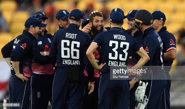 England players congratulate Moeen Ali after he had dismissed Tom Latham first ball during the 3rd ODI between New Zealand and England at Westpac...