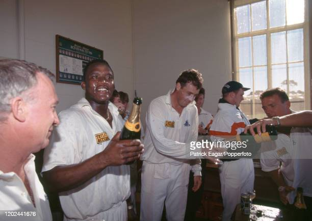 England players Devon Malcolm Angus Fraser and Alec Stewart celebrate with champagne in the England dressing room after England won the 4th Test...