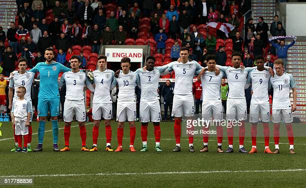 England players during the National anthem ahead of the U20 International Friendly match between England and Canada at the Keepmoat Stadium on March...