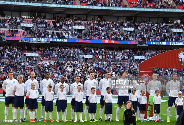 England players England's midfielder Ross Barkley England's midfielder Jordan Henderson England's striker Marcus Rashford England's midfielder Raheem...