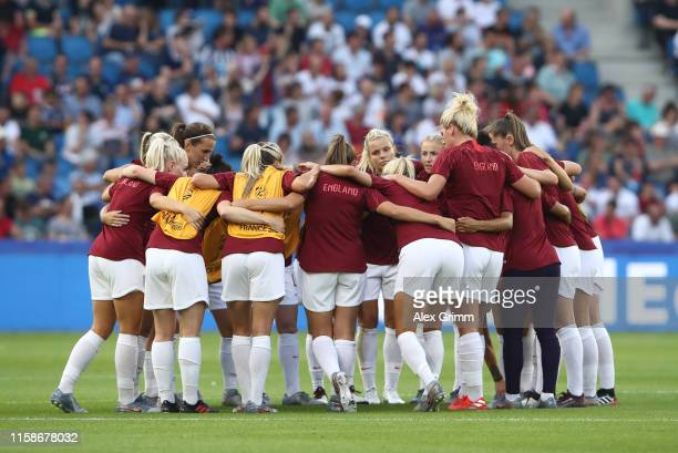 England players form a team huddle prior to the 2019 FIFA Women's World Cup France Quarter Final match between Norway and England at Stade Oceane on...