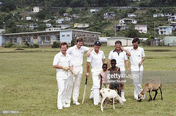 England players from left David Bairstow; Chris Old; Geoffrey Boycott, Tour manager Ken Barrington and Geoff Miller pose with local children and...
