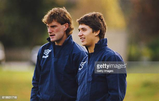 England players Glenn Hoddle and Gary Lineker look on during an England training session circa 1986