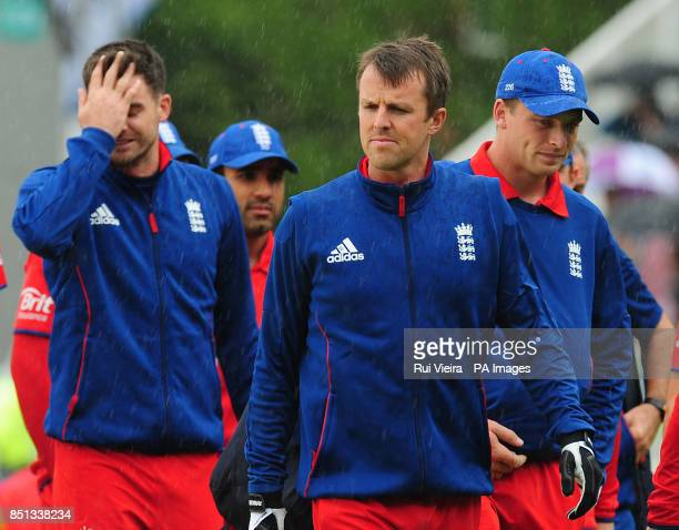 England players go back to pavilion as rain stops play for a second time during the ICC Champions Trophy Final at Edgbaston Birmingham