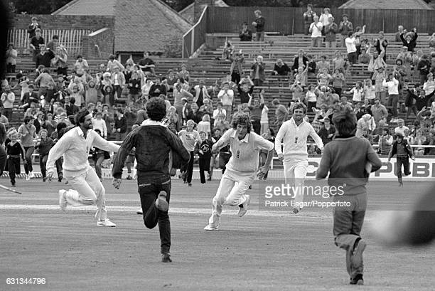 England players Graham Gooch Bob Willis and Mike Gatting run from the pitch after England had won the 3rd Test match between England and Australia at...