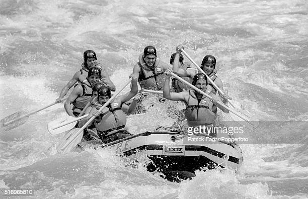 England players Ian Botham Allan Lamb David Gower Chris Smith and Graeme Fowler go whitewater rafting before the 3rd Test between New Zealand and...