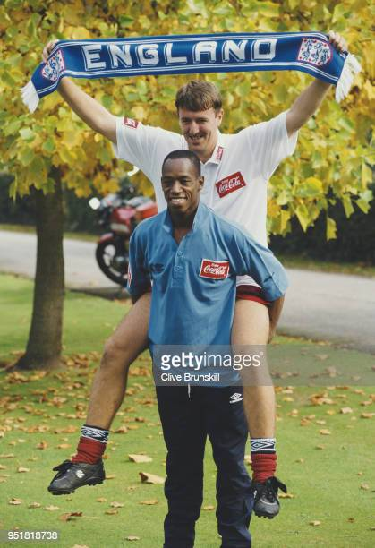 England players Ian Wright and Matthew Le Tissier take part in a tabloid picture set up with an England scarf during an International get together...
