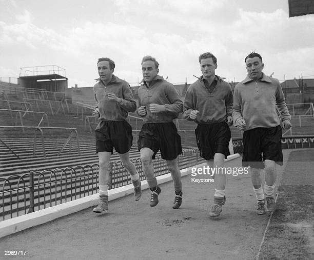 England players in training at Arsenal's Highbury ground in London, 11th April 1951. Left to right: Harold Hassall , Billy Wright , Tom Finney and...