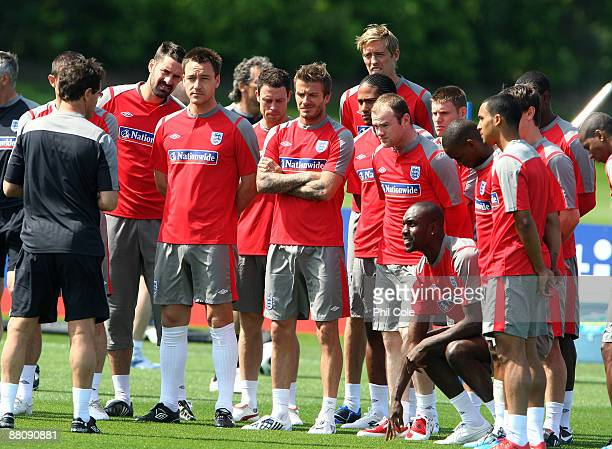 England players including John Terry, David Beckham and Wayne Rooney listen to England manager Fabio Capello during the England training session at...