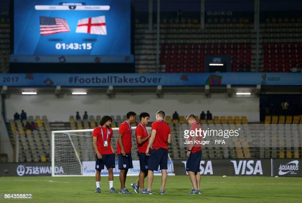 England players inspect the pitch ahead of the FIFA U17 World Cup India 2017 Quarter Final match between USA and England at Pandit Jawaharlal Nehru...