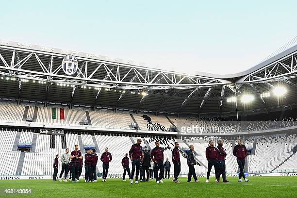 England players inspect the pitch during an England team stadium visit ahead of the International Friendly match against Italy at Juventus Arena on...