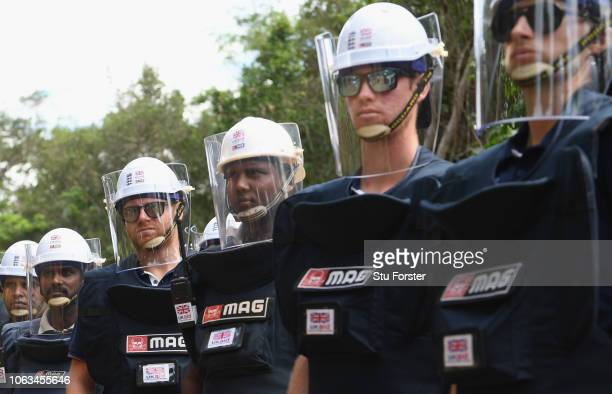 England players Jonny Bairstow Keaton Jennings and Joe Root fitted out with demining personal protective equipment listen to a briefing before a tour...
