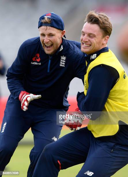 England players Jos Buttler and Joe Root share a joke during a game of football during England nets ahead of the 1st ODI against West Indies at Old...