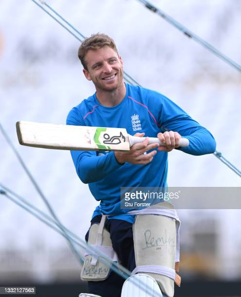 England players Jos Buttler smiles during England nets ahead of the First Test match against India at Trent Bridge on August 03, 2021 in Nottingham,...
