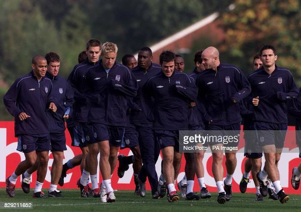 England players Kieron Dyer Wayne Bridge Jon Woodgate Alan Smith Emile Heskey David Thompson Danny Mills Frank Lampard jog around the pitch during a...