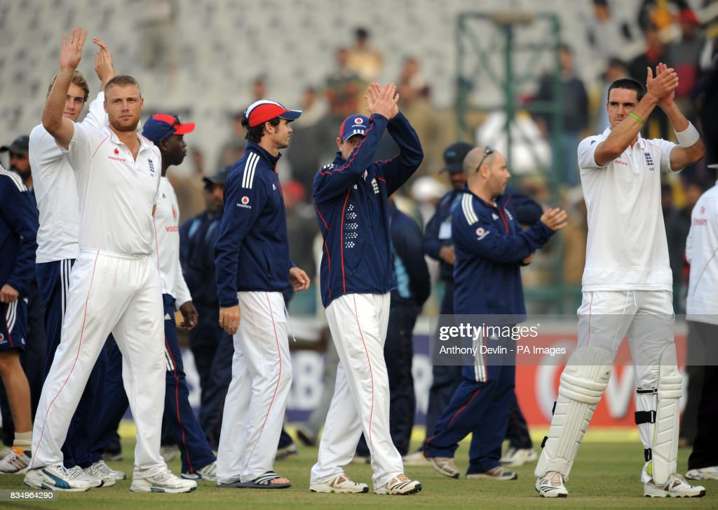 England players leave the field following the close of play on the fifth day of the second test at the Punjab Cricket Association Stadium Mohali India