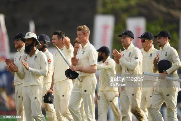 England players leave the field including Keaton Jennings Jack Leach and Rory Burns after winning the match by 211 runs during Day Four of the First...