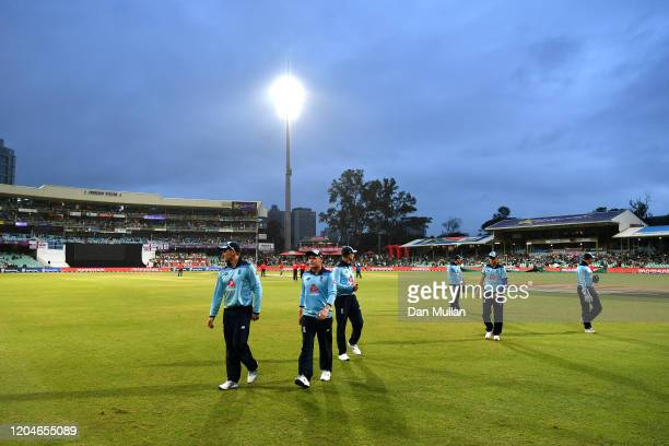 England players leave the pitch following poor weather conditions during the Second One Day International match between England and South Africa at...