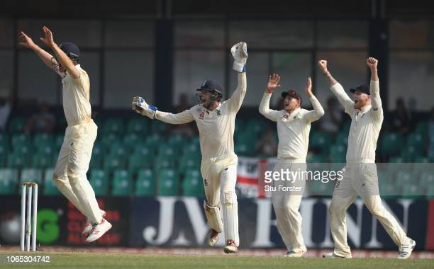 England players left to right short leg fielder Keaton Jennings Ben Foakes Joe Root and Ben Stokes appeal in vain for the wicket of Lakmal during Day...