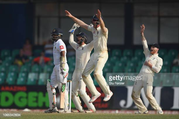 England players left to right short leg fielder Keaton Jennings, Ben Foakes and Ben Stokes appeal with success for the wicket of Suranga Lakmal after...