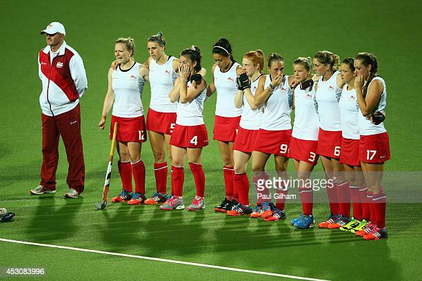 England players look dejected after losing the penalty shoot out to Australia in the Women's Gold Medal Final match between Australia and England at...