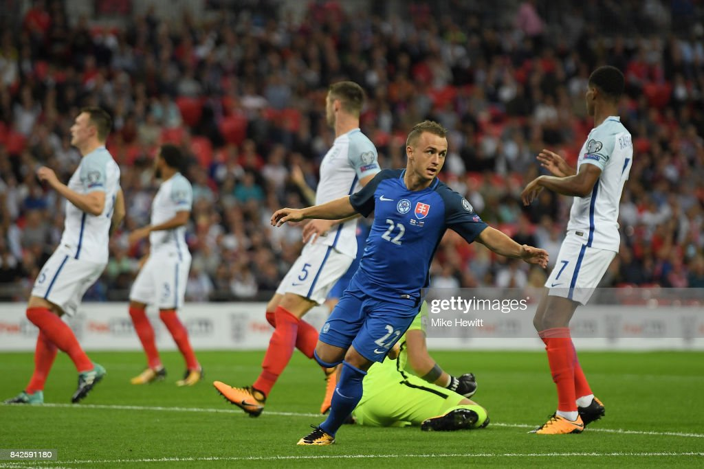 England players look dejected as Stanislav Lobotka of Slovakia celebrates as he scores their first goal during the FIFA 2018 World Cup Qualifier between England and Slovakia at Wembley Stadium on September 4, 2017 in London, England.