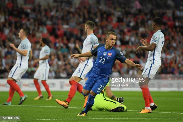 England players look dejected as Stanislav Lobotka of Slovakia celebrates as he scores their first goal during the FIFA 2018 World Cup Qualifier...