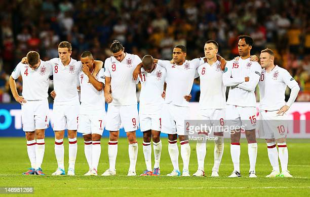 England players look on during the penalty shoot out during the UEFA EURO 2012 quarter final match between England and Italy at The Olympic Stadium...
