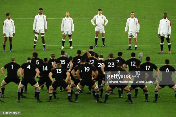 England players look on while New Zealand players perform a haka during the Rugby World Cup 2019 Semi-Final match between England and New Zealand at...