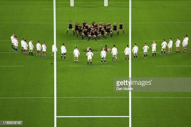 England players look on while New Zealand players perform a haka during the Rugby World Cup 2019 SemiFinal match between England and New Zealand at...