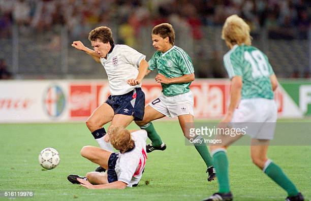England players Mark Wright and Peter Beardsley combine to thwart Olaf Thon of West Germany during the 1990 FIFA World Cup Semi Final at Stadio delle...