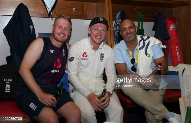 England players Matt Parkinson and Dom Bess with former player Mark Butcher pictured in the dressing room after Day Four of the Fourth Test between...