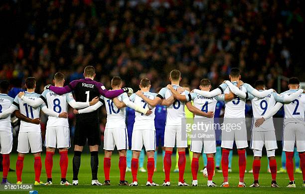England Players observe a minute of silence for the victims of Brussels terror attacks prior to the International Friendly match between England and...