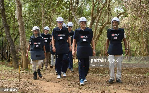England players Olly Stone and Jonny Bairtsow in de-mining personal protective equipment on a tour of a previously cleared area of mine site during...