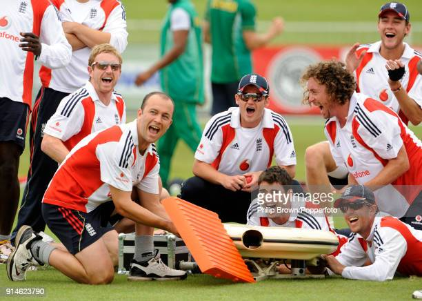 England players Paul Collingwood Jonathan Trott Steven Davies James Anderson Ryan Sidebottom Graeme Swann and Stuart Broad laugh after aiming balls...