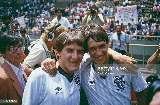 England players Peter Beardsley and Gary Lineker after their team beat Paraguay 3-0 in a Round of 16 match during the World Cup competition at the...