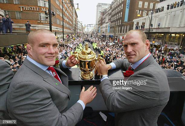 England players Phil Vickery and Lawrence Dallaglio hold the Webb Ellis Cup during the England Rugby World Cup team victory parade December 8, 2003...