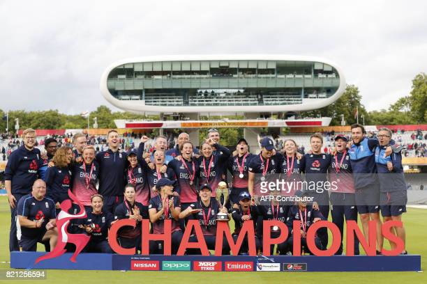 England players pose with the trophy after winning the ICC Women's World Cup cricket final between England and India at Lord's cricket ground in...