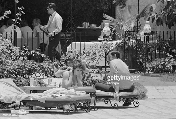 England players relaxing by the side of the swimming pool at their hotel with Gordon Banks and Susan Maughan on the sun loungers 6th June 1970