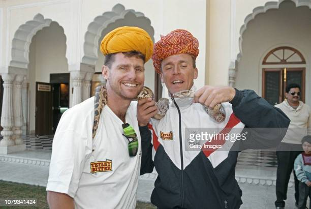 England players Robin Smith and Alec Stewart pictured posing with a snake during the 1993 England Cricket Tour to India