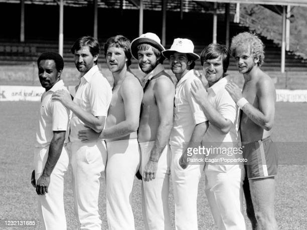 England players Roland Butcher, Graham Gooch, Ian Botham, Peter Willey, Geoff Miller, Mike Gatting and David Gower pose for photos during a training...