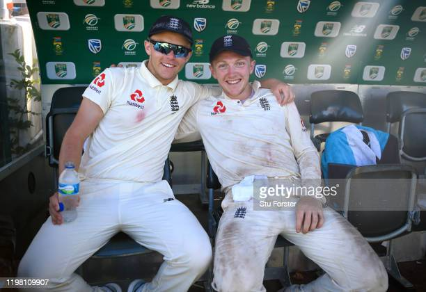 England players Sam Curran and Dom Bess celebrate victory after Day Five of the Second Test between South Africa and England at Newlands on January...